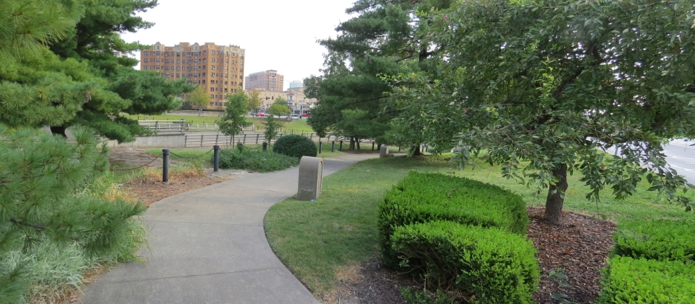 View walking to tour stop along south side of Brush Creek